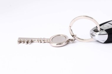 Picture of car key with key ring. Isolated on white background.