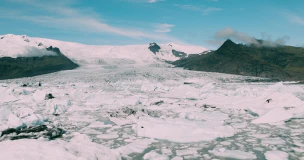 Aerial view flying over Fjallsarlon glacier lagoon icebergs in Iceland
