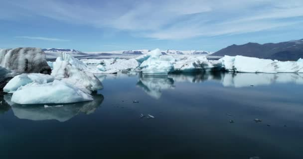 Low flying aerial view of beautiful Jokulsarlon blue glacier lagoon with giant icebergs in Iceland