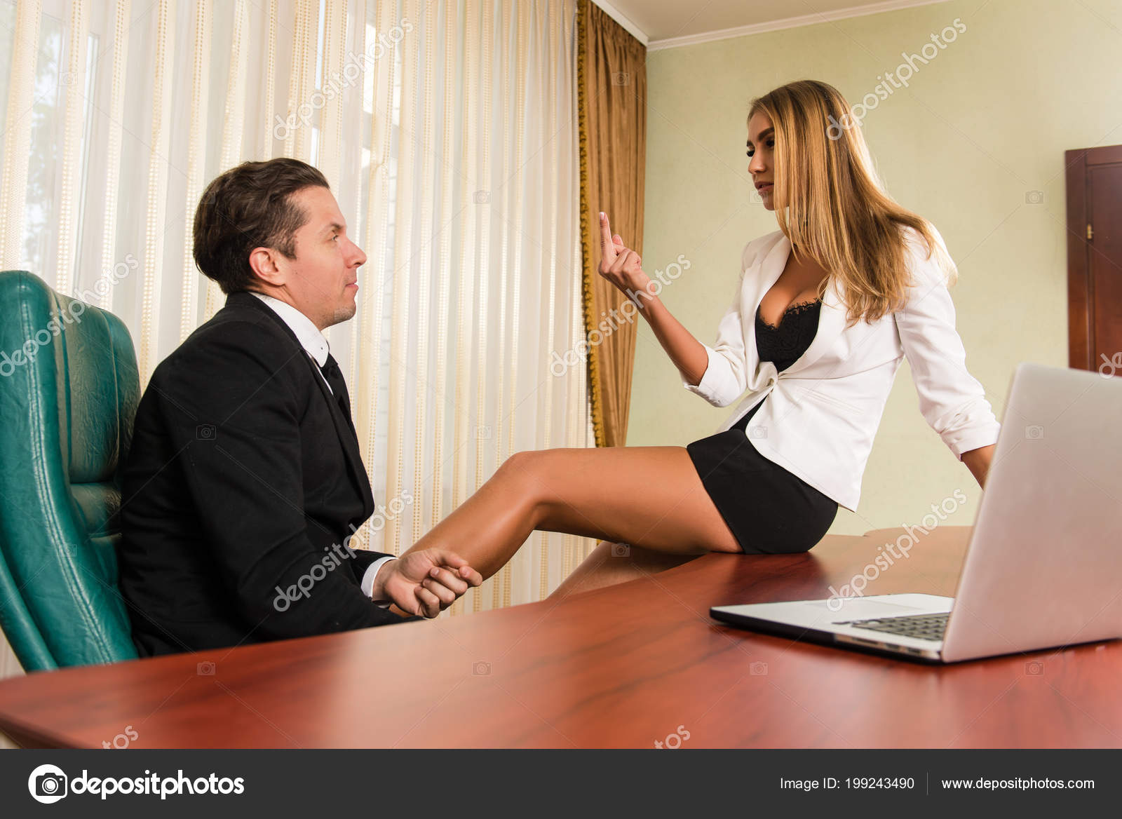 6f0deda35904e3 Beautiful girl show middle finger to her boss indoors. Woman showing middle  finger. Secretary is sitting on table. — Photo by 160275