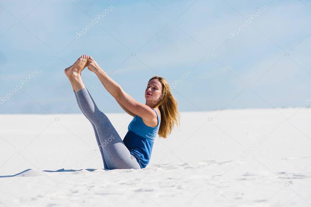 Beautiful female stretch her legs in desert