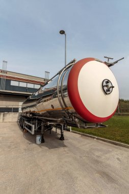 ZAGREB, CROATIA - OCTOBER , 2016: Trailer tank with dangerous flammable goods on parking lot in chemical warehouse, front view
