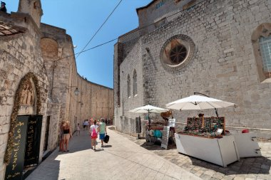 DUBROVNIK, CROATIA - JULY 13, 2016: Summer scene of the entrance to City Walls, Chapels of Announcement and of St. Luke near Ploce Gate in city of Dubrovnik, Croatia