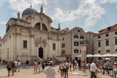 DUBROVNIK, CROATIA - AUGUST 13, 2015:  St. Blaise Church (Crkva sv. Vlaha), Orlando column and tourists in city of Dubrovnik ,Croatia