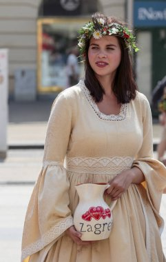 ZAGREB, CROATIA - AUGUST 05, 2015:A girl dressed as Manda, which according to tradition was met knight who asked her water. He told her,