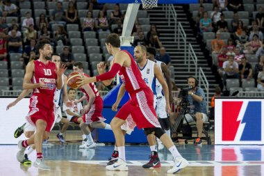 ZAGREB, CROATIA - AUGUST 28, 2015: The preparatory match ahead of the EuroBasket 2015 between Croatia and Israel. Croatian players passing the ball