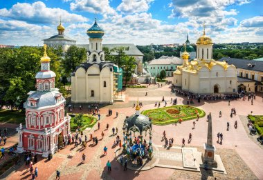View of the temples of the Lavra in Sergiev Posad from the height of the bell tower on a summer sunny day