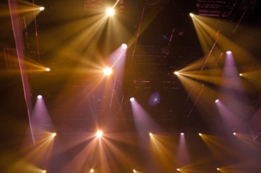 Beautiful colour of gold and pink stage lights in concert