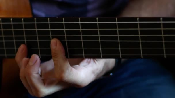 Man plays on the classical guitar close up footage