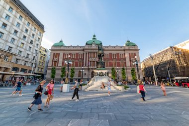 Belgrade, Serbia - August 27, 2020: Prince Mihailo Obrenovic monument and building of National museum in Belgrade. People walk on the most famous square in the center of Belgrade.