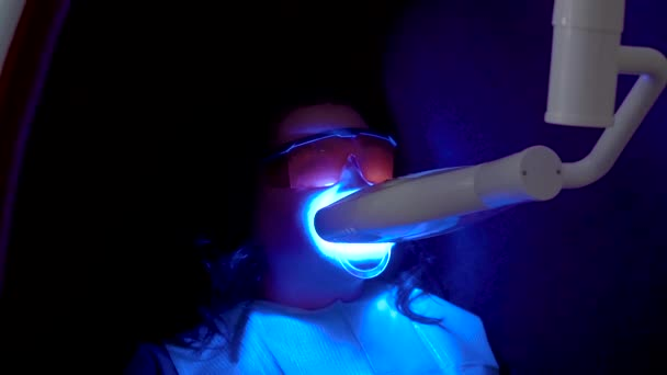 Teeth whitening procedure with ultraviolet light UV lamp