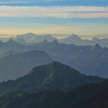 Early morning in the Swiss Alps. View from Mount  Rigi. Mountain ranges and valleys.
