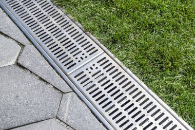 street separation stormwater drainage, for drainage and separation of water from the lawn and paving slabs.
