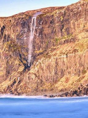 Popular waterfall in Talisker bay, Scotland.  Popular photographers destination