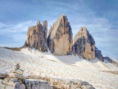 Sharp stones stacked into pyramid.  Mountain ridge in Italian Dolomites Alps in early summer.