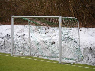Soccer play field grass in winter. Artificial green turf texture