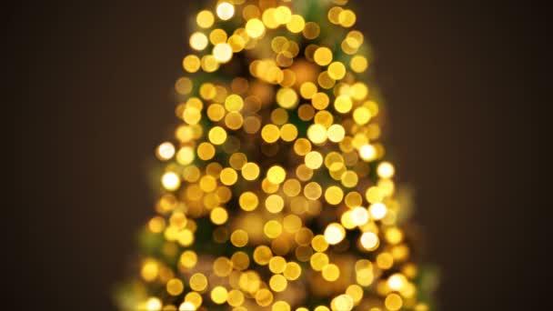 Krásný zlatý nový rok strom světla v Bokeh rozostřeného rozostření. Pozdrav pozadí bezproblémovou 3d animace. Veselé Vánoce a šťastný nový rok oslava konceptu. 4 k Ultra Hd 3840 x 2160