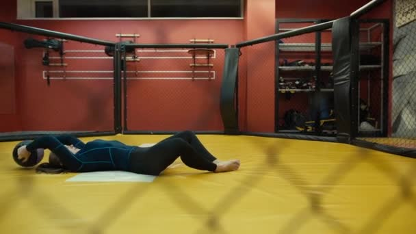 Woman training in the gym - from lying to sitting position with medicine ball