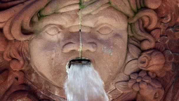 Face Sculpture and Fountain
