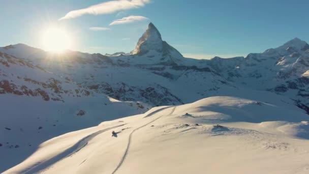 Matterhorn Mountain and Sun at Sunset in Winter. Swiss Alps. Switzerland. Aerial View. Drone Flies Backwards