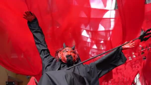 devil mannequin n the street during halloween celebration