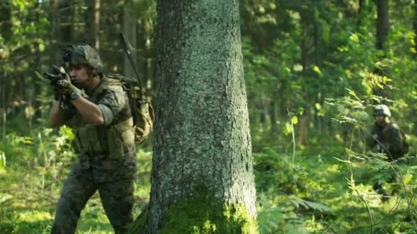 Squad of Five Fully Equipped Soldiers in Camouflage on a Reconnaissance Military Mission, Running from Behind the Cover. They're Moving in Formation Through Dense Forest. Shot in Slow Motion.