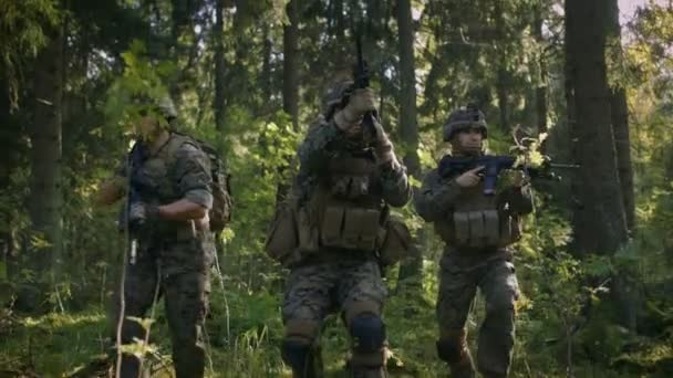 Three Fully Equipped Soldiers Wearing Camouflage Uniform Attacking Enemy They Re In Shooting Ready Stance Aiming Rifles Military Operation In Action Squad Standing In Dense Forest