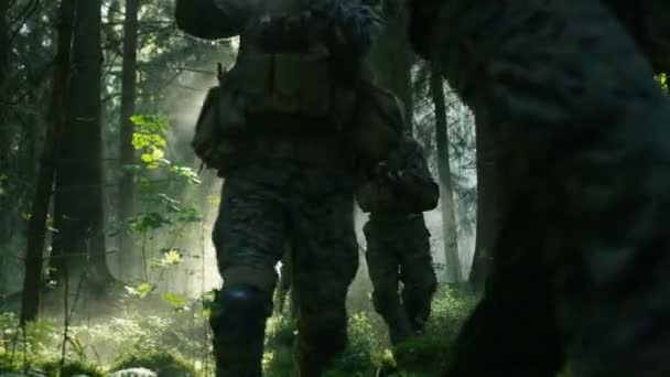 Squad of Five Fully Equipped Soldiers in Camouflage on a Reconnaissance Military Mission, Rifles Ready to Shoot. Theyre Moving in Formation Through Dense Smokey Forest.