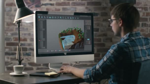 Video Game Designer Works on a New 3D Level on His Personal Computer. He Works as a Developer in a Creative Office Environment.