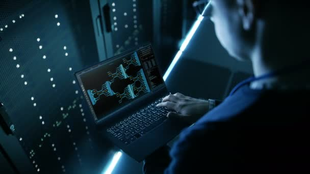 Data Center Engineer Holds Laptop and Works Controls System Stability.