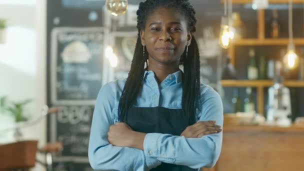 Beautiful African-American Cafe Owner Standing with Crossed Arms and a Smile in Her Stylish Coffee House.