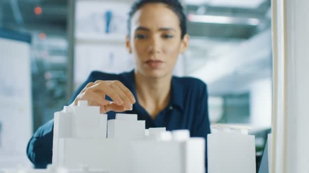 Female Architectural Designer Adds Component to a Building Model, She Works on a City District Urban Planning Project. Beautiful Woman in Stylish Office.