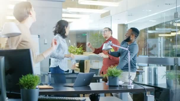 Diverse Group of Young Women and Men Dance and Have Fun in the Modern Office.
