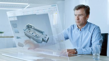 In the Near Future Professional Engineer Works on Transparent Computer Display with Clear Screen Great for Mock-up Template. He Works in a Bright and Modern Office.