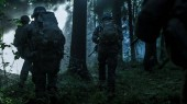 Fully Equipped Soldiers Wearing Camouflage Uniform Attacking Enemy, Rifles Ready to Shoot. Military Operation in Action, Squad Running in Formation Through Dark Dense Smokey Forest.