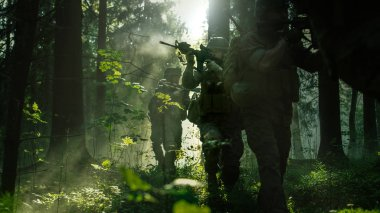 Squad of Five Fully Equipped Soldiers in Camouflage on a Reconnaissance Military Mission, Rifles Ready to Shoot. They're Moving in Formation Through Dense Sunny Forest.