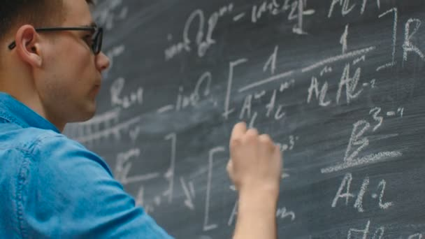 Brilliant Young Mathematician Writes Complex Math Equation/ Formula on the Blackboard.