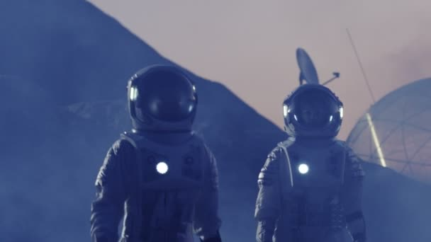 Male and Female Astronauts wearing Space Suits Explore Violet Alien Planet. Futuristic Space Exploration, Discovery and Colonization. Beautiful, Hypnotic Footage.