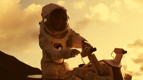 Astronaut in the Space Suit Adjusts Rover for Expedition/ Research on the  Mars/ Red Planet  First Manned Mission To Mars, Technological Advance  Brings Space Exploration, Travel, Colonization Concept