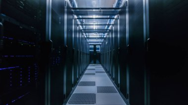 Data Center With Between Two Rows of Fully Operational Server Racks. Modern Telecommunications, Cloud Computing, Artificial Intelligence, Database, Supercomputer Technology Concept.