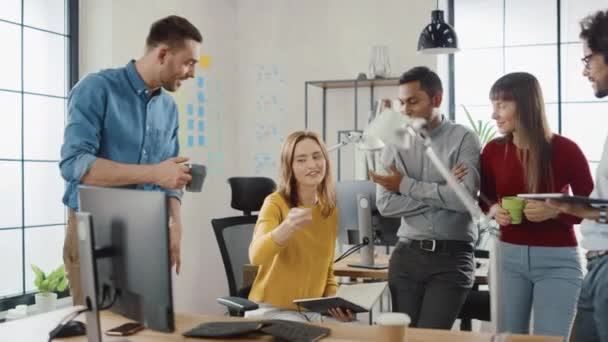 In the Modern Office: Diverse Group of Colleagues Have Meeting, Develop Strategy, Discuss Project Progress, Customer Experience Management also Have a bit Of Fun and Jokes. Smiling Businesspeople Chat