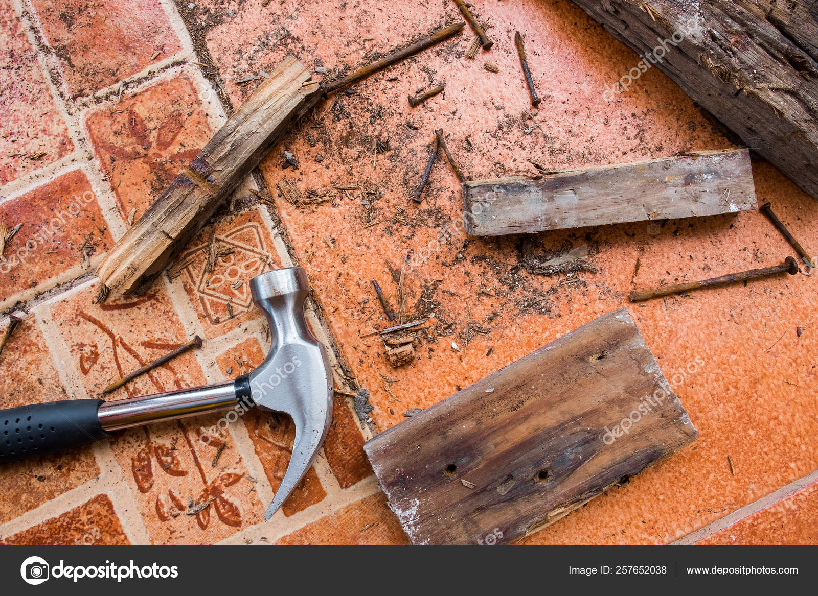 The House Of Hammer workers are repairing the house and using a hammer to pull