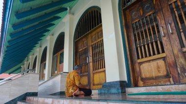 sholat people in masjid wear batik clothes