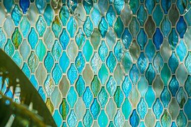 Blue and aqua glass tile wall in the Enid A. Haupt Garden, Smithsonian Castle, Washington, D.C., USA.