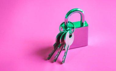 Silver padlock and keys background.
