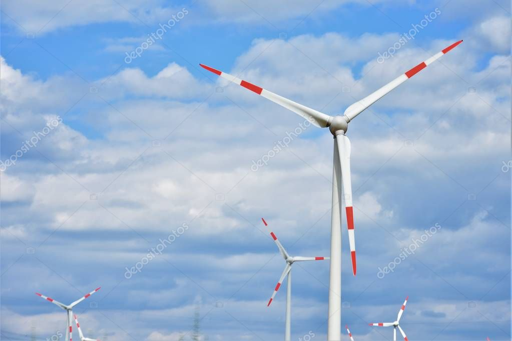windmill on a background of blue sky with white clouds