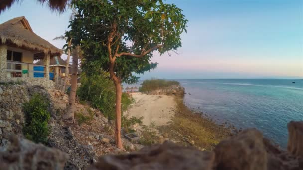 Malapascua Island Philippines Beach Cebu Visayan Sea Day Night Time Lapse Of Resort Tourists On Tropical Beach With Crowds Of People On Coral Sand Beach Near Rocky Beach Rocks On Sea Shoreline