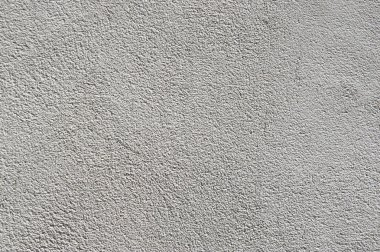 gray plaster on the insulated walls of the facade