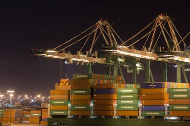 Port Cranes doing loading work at night.
