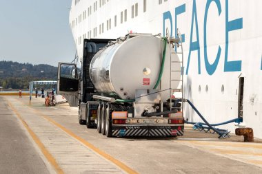 Corfu, Greece - October 1th, 2018: A Volvo truck cistern refueling a cruise ship docked at the Port or Corfu.